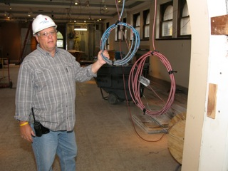 Brian Barger, Project Superintendent, Hunter Roberts Construction Group, stands in what will be the first gallery for Secrets of the Silk Road, by newly installed metal clad cable for recessed lights that will be a new feature of the gallery ceilings.