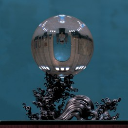 The Crystal Ball against the turquoise background of the Penn Museum's Chinese Rotunda.