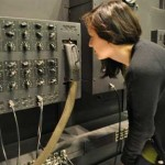 Pre-program intern Vicki Chisholm examining ENIAC components as part of the condition survey.