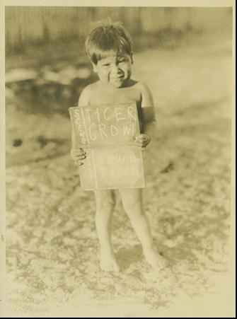 A  little boy holding a slate or chip chart to identify a scene  ( # 27414)