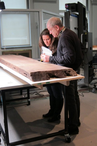 Dr. David Silverman and Leah Humphrey examining the texts on one of the coffin boards