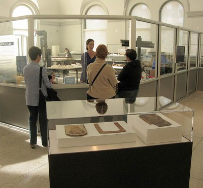 Chatting with visitors through one of the open windows in the Artifact Lab