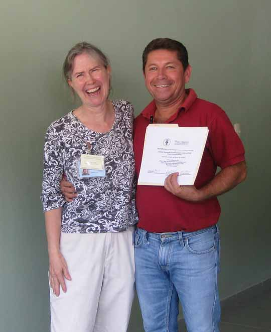 Luis Reina, director of the Copan Sculpture Museum, accepts his Workshop Certificate from Dr. Loa Traxler