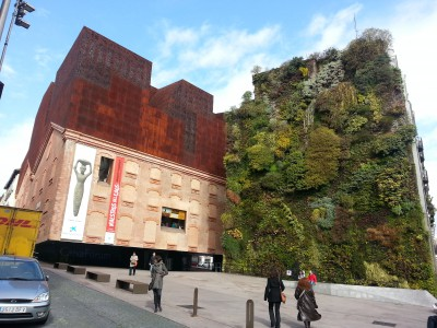 CaixaForum Madrid and the adjacent Vertical Garden.