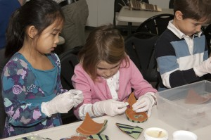Abington School District 2nd graders piece together pots during a conservation workshop.