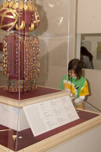 An Abington 2nd grader jots down reflections about Lady Puabi's jewels. Photo: Dari Sutton