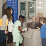 The Abington 2nd grade guest interpreters examine a case in the Iraq's Ancient Past exhibition.  Photo:  Dari Sutton