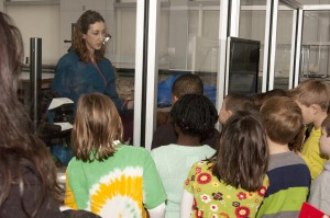 Molly Gleeson gives a special presentation from the Artifact Lab for the 2nd graders.  Photo:  Dari Sutton