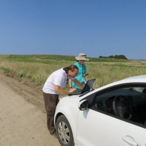 Here me and another team member are using our coordinates and GPS to locate and elusive tumulus.  (Photo by: Amanda Ball)