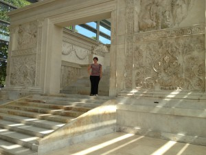 The Ara Pacis is a four-walled enclosure with sculpted relief inside and out.