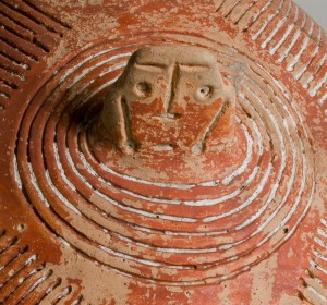 Detail of the incised face and surrounding decoration.