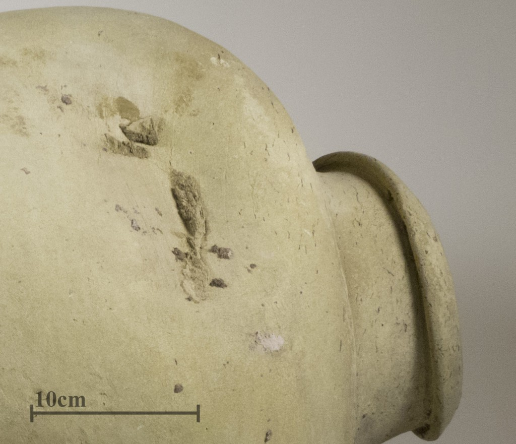 Detail of 31-16-160 showing the rim of another vessel that fused to the object during firing