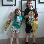 Mara and Konrad, Family Second Sunday veterans, pose with their kites.  Mara and Konrad have been attending the program for the past two years and have made about 10 crafts.