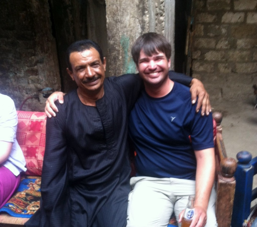 Houmdi (left) and I (right) at his daughter's wedding, sitting in the courtyard of his home built within the area of the Malih. Photo from Jamie Kelly