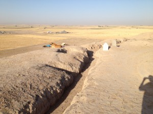 Military trench on top of the tell, looking over the plain towards Mosul