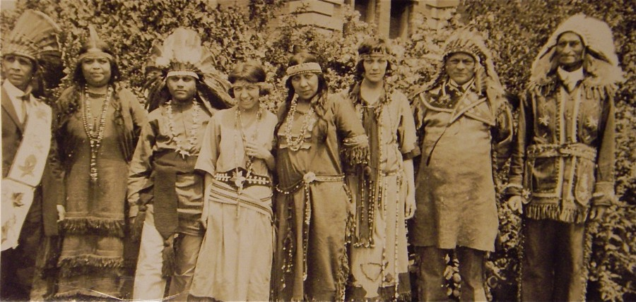 Members of the Algonquin Council of New England at Roger Williams Park in Providence, Rhode Island in 1924. (left-right) Chief Leroy Perry (Pocasset Wampanoag), Mrs. Steele (Narragansett), Chief Robert Clark (Nanticoke), Gladys Tantaquidgeon (Mohegan), Perry Congdon (Mohegan), Gertrude Harrison (Mohegan), Chief Mitchell (Narragansett), Joe Strong Wolf. Photo by Frank Speck, Penn Museum Archives.