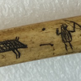 Close-up of hunting scene on bow drill.