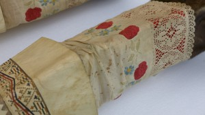Detail of Eskimo (Inuit) women's boots, showing linen, embroidery, and stains. Photo by Margaret Bruchac, with permission