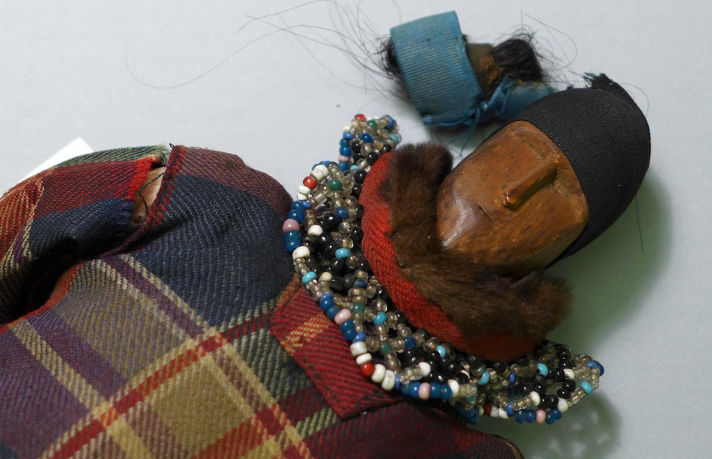 Close-up of beadwork collar on Inuit doll from Arsuk, Greenland