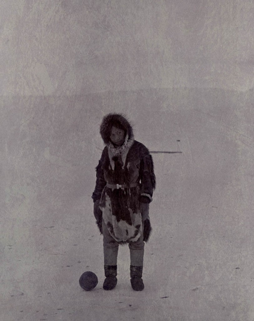 Eskimo girl with soccer ball.  Point Barrow, Alaska.  Photograph by E. A. McIlhenny, 1897-1898.