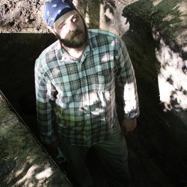 Kyle Olsen standing in the excavation unit on Mound A.