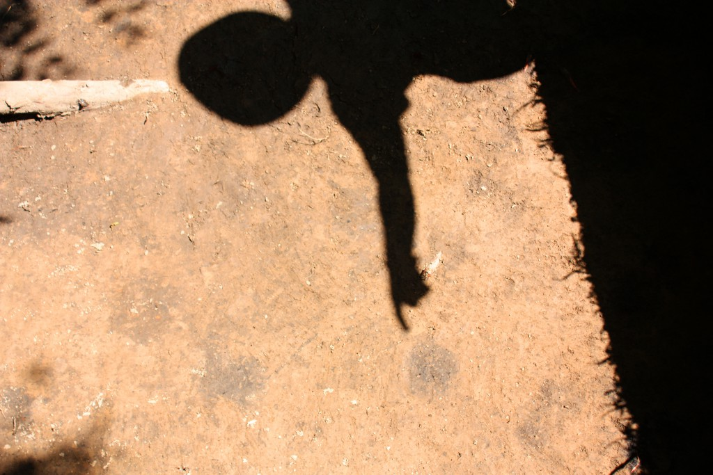 Meg's shadow points to an archaeological feature in the south plaza. Photo by Tom Stanley.