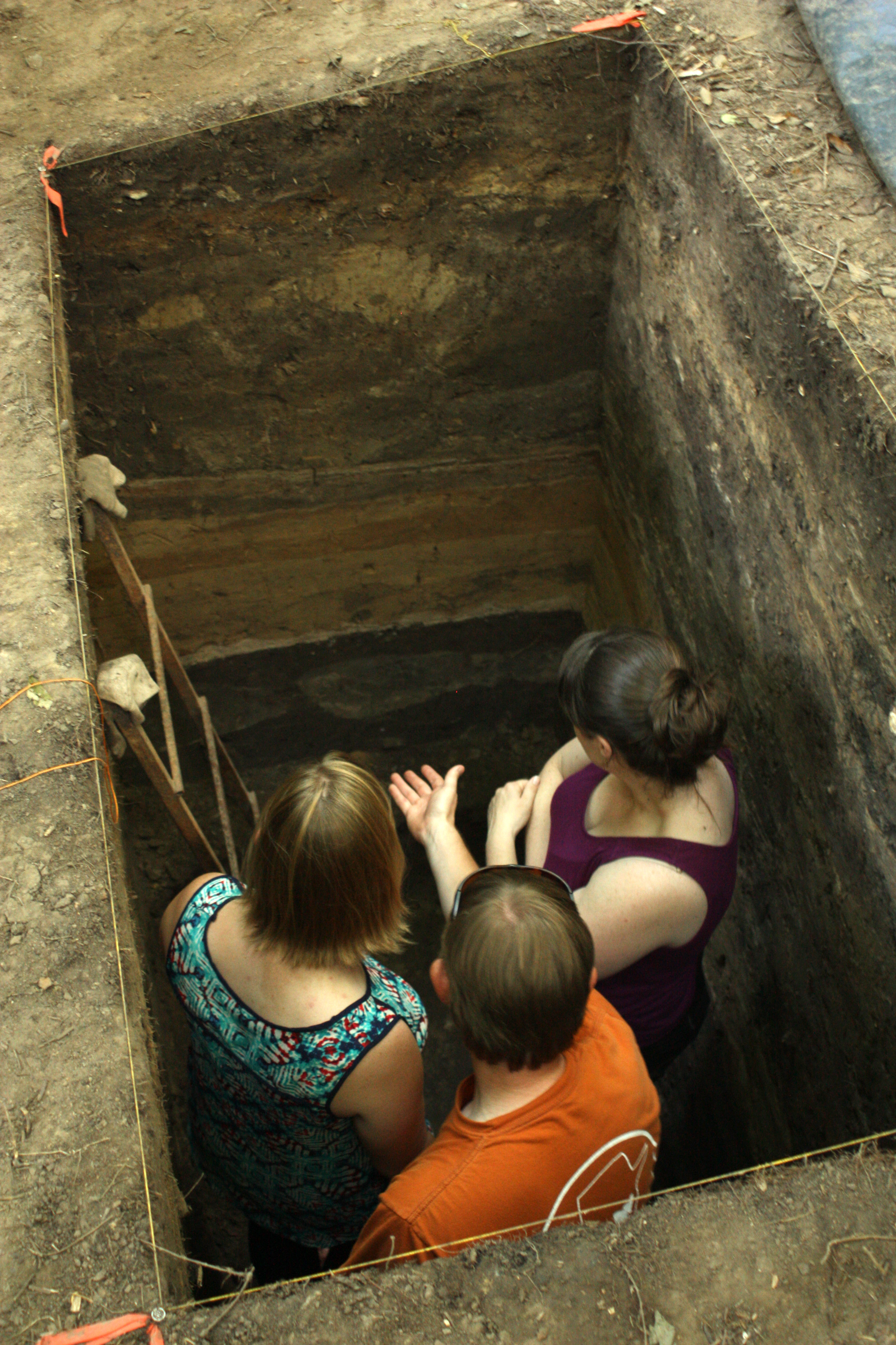 Taking a close look at soil layers in the excavation unit at Mound A.