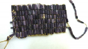 """Wampum Neck Band in course of construction,"" object number 014012.000 at the National Museum of the American Indian, Washington, DC. Collected by Walter C. Wyman in 1907. Photograph by Zhenia Bemko."