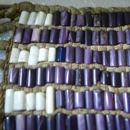 Detail of mid-18th century wampum belt showing the inclusion of a single blue glass bead in the original weave of shell wampum beads. Photograph by Lise Puyo.