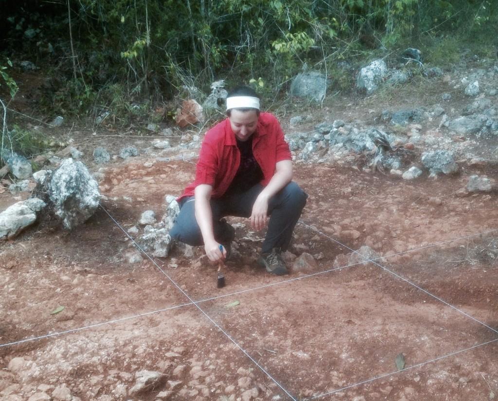 Elizabeth excavating house platform. Photo Credit: Kristen Fellows