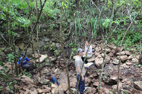 Excavating inside the looter's pit of La Selva's main structure. Photo by Saul Ascencio.
