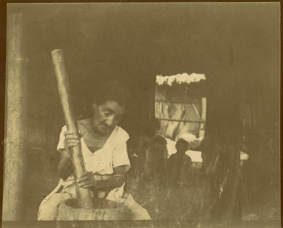 Indian woman pounding maize, Yateras, Cuba. From Stewart Culin's 1901 Expedition to Cuba. Penn Museum image no. 240599A