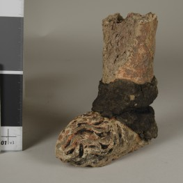 35-1-127: a leg and foot of a figure with a repair at the ankle.