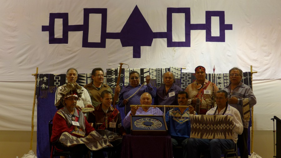The main speakers holding historic wampum, left to right, front row: Bobby Brown, Kanento:ken, Tom Porter, Leroy Hill, and Sid Hill. Back row, left to right: Ernest David, Richard Mitchell, Howard Elijah, Ken Maracle, Jamie Jacobs, and Howard Thompson. Photo by the author.