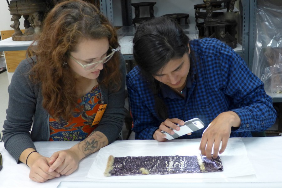Sarah Parkinson (left) and Stephanie Mach studying ROM 911.3.130.B. Photo by Dr. Bruchac.