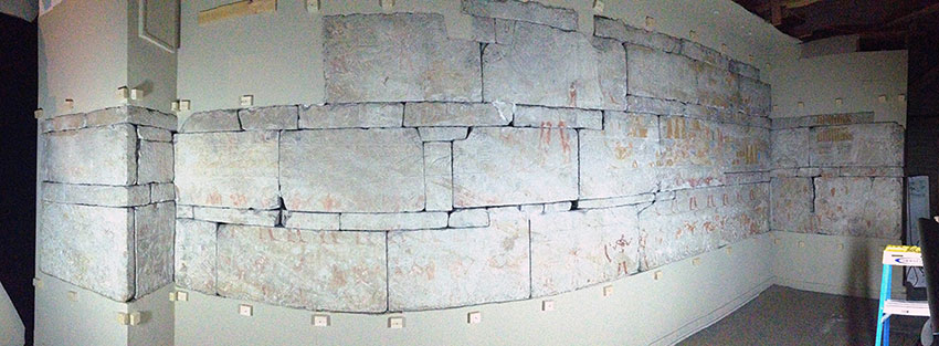 Figure. 1: A panorama image of the east and south walls of the tomb chapel taken from inside the current enclosure (image distortion is a byproduct of the panorama capture).