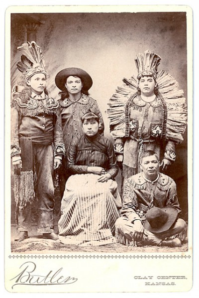 "Cabinet card showing a group of Haudenosaunee (Iroquois) medicine show entertainers. Period inscription on the back of the card reads: ""Caughnawaga [Mohawk] Indians with the Kickapoo Medicine Company. Season 1891. R.W. Telford, Manager."" Photos courtesy of Gerry Biron. Private collection."