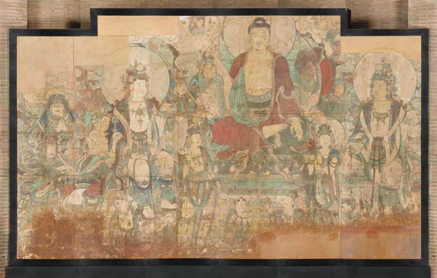 The central figure in this mural is Bhaisajyaguru, the Medicine Buddha. He is associated with longevity and guards against untimely death, nightmares, evil apparitions, vicious animals, robbers, thieves, and invading states. He is the central figure in an important Buddhist text called the Sutra of the Original Vows of the Master of Medicines Buddha of Lapis Lazuli Radiance , which describes his merits and various ways he comes to aid those beset by sufferings and calamities
