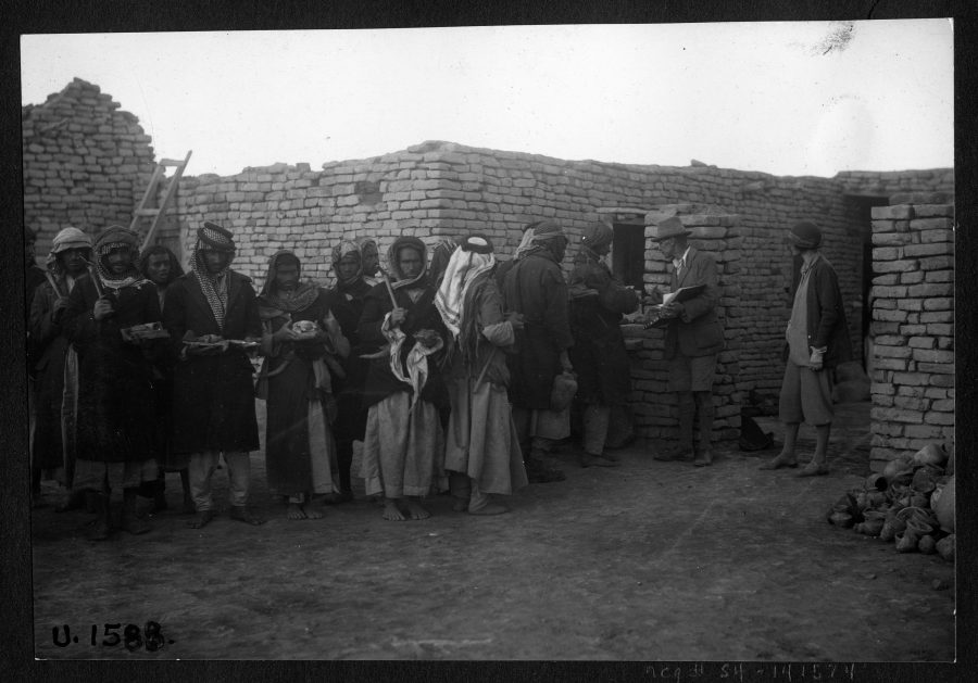 Woolley inspecting artifacts to assign baksheesh in 1930. UPM Field Photo 191588.