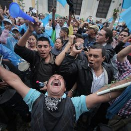 people in Guatemala celebrate the end of a reign of terror