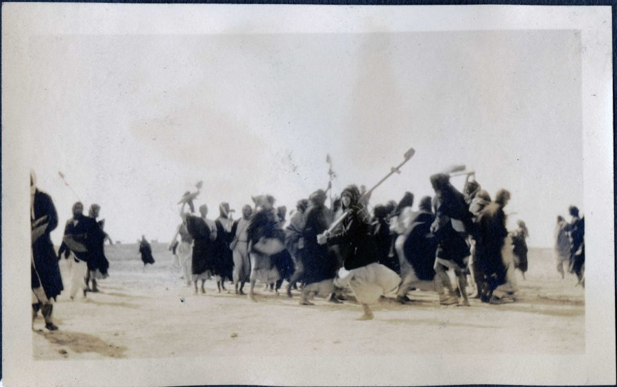 Photo taken by Father Leon Legrain in 1926 showing workers celebrating at the end of the day.