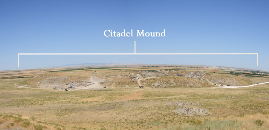 A wide view of the Citadel Mound at Gordion, with cars along the road for scale.