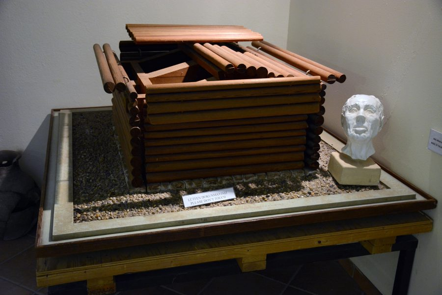 A model of the tomb chamber inside Tumulus MM, with a cranial reconstruction of the man found inside (which also appears in the Penn Museum's King Midas exhibition).