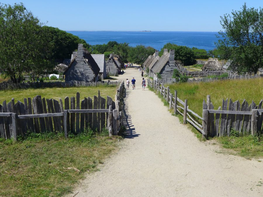 Tourists approach the English village site at Plimoth Plantation. Photo by Margaret Bruchac.