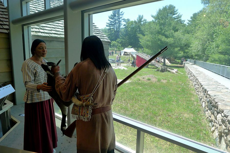 Caption: Dioramas inside, and living history outside, at the Mashantucket Pequot Museum. Photo by Lise Puyo.