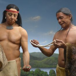 Caption: Diorama of two men exchanging wampum and beaver furs, at the Mashantucket Pequot Museum. Photo by Marge Bruchac.