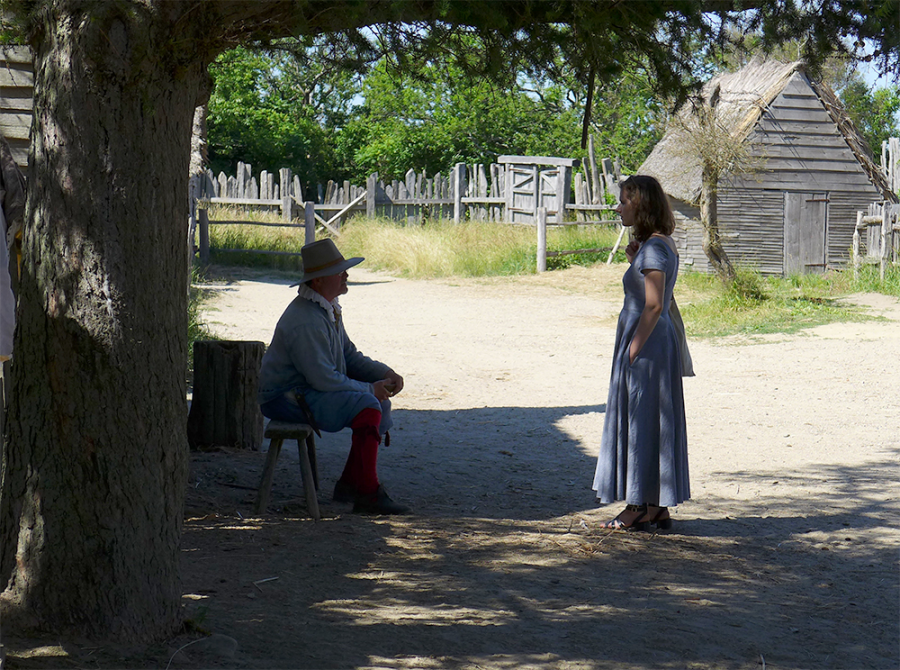 Listening to a colonial interpreter in the recreated 17th century English village at Plimoth Plantation. Photo by Margaret Bruchac.
