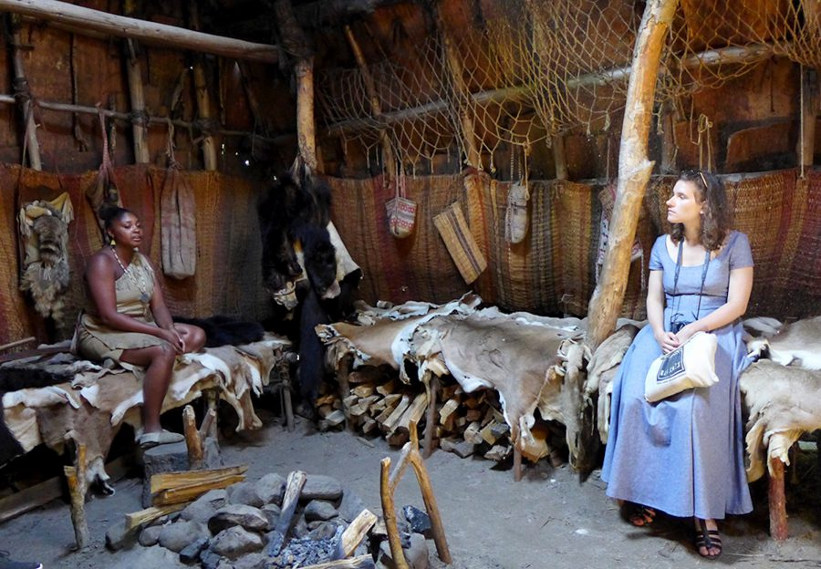 Listening to Talia, an interpreter on the Wampanoag side of Plimoth Plantation. Photo by Margaret Bruchac.