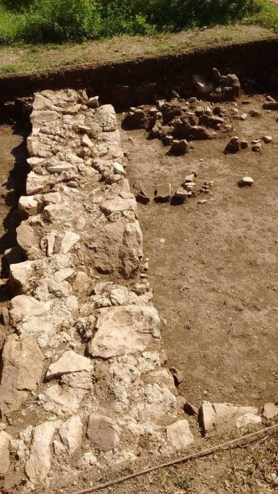 A view of the villa's western external wall in trench two, from the North. Photo by Jordan Rogers.