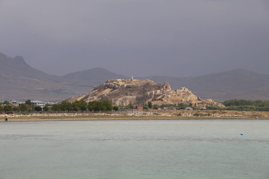 Van Castle, as seen from across Lake Van, with mountains in the background. Photo credit: Rachel Cohen.